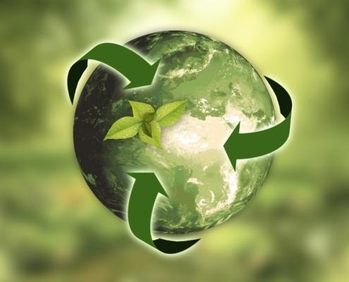 Ziemia na tle zielonym ze znaczkiem recyklingu, ilustracja do informacji
